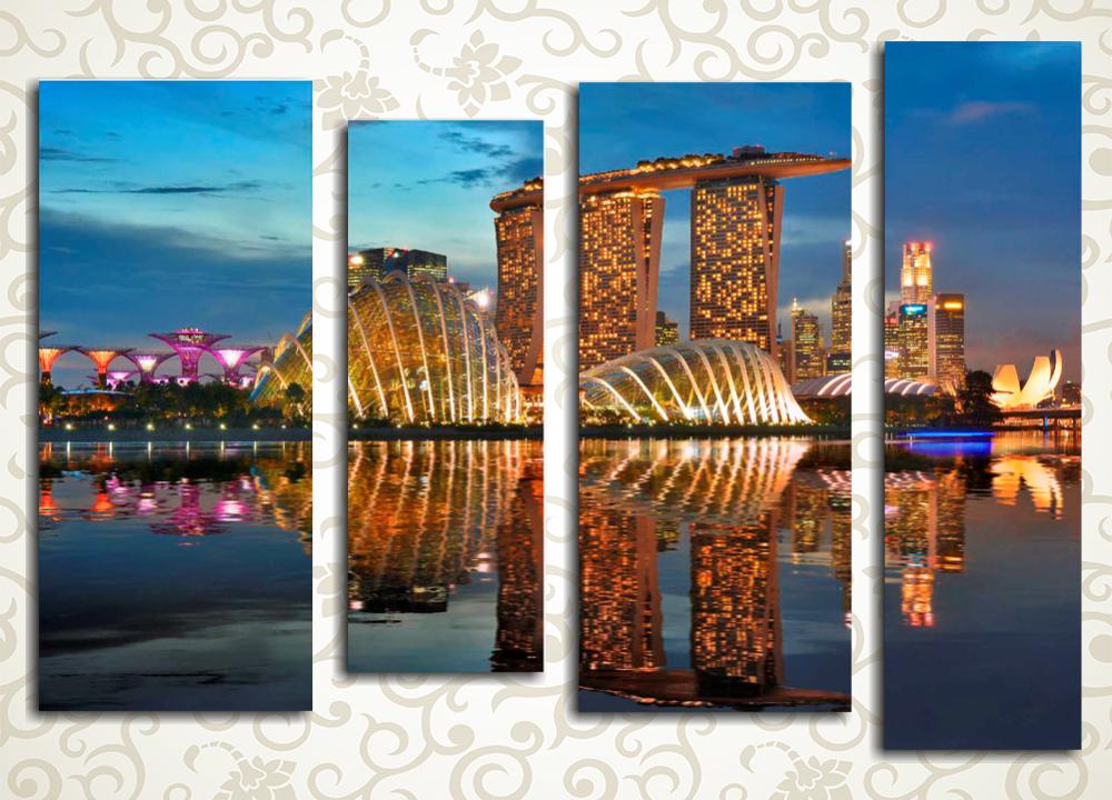 Модульная картина Огни ночного СингапураМодульная картина «Огни ночного Сингапура» изображает восхитительный пейзаж – залитый огнями мегаполис на берегу морского залива. Это полотно украсит интерьер гостиной, прихожей, холла, а также зала. Изображение состоит из 4 вертикальных модулей. Каждый сегмент собран на сосновом каркасе и вручную обтянут холстом. Холст обеспечивает максимально естественное восприятие изображения.<br>