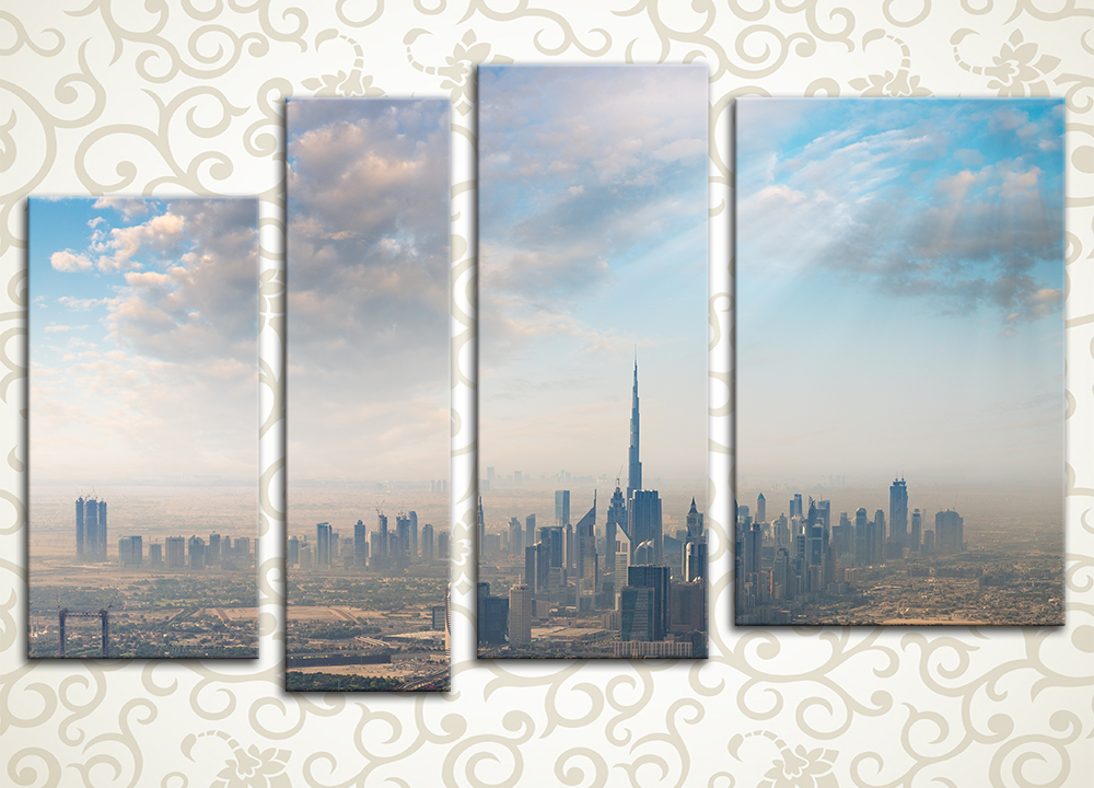Модульная картина Дубаи в облакахЧуть подернутая нежной дымкой панорама современного мегаполиса предстает перед нами на модульной картине «Дубаи в облаках». Изображение в приглушенных и воздушных оттенках поделено на 4 вертикальных блока разной высоты и ширины, что придает картине глубину и динамику, создавая впечатление реалистичности. Холсты натянуты на подрамники исключительно ручным способом.<br>