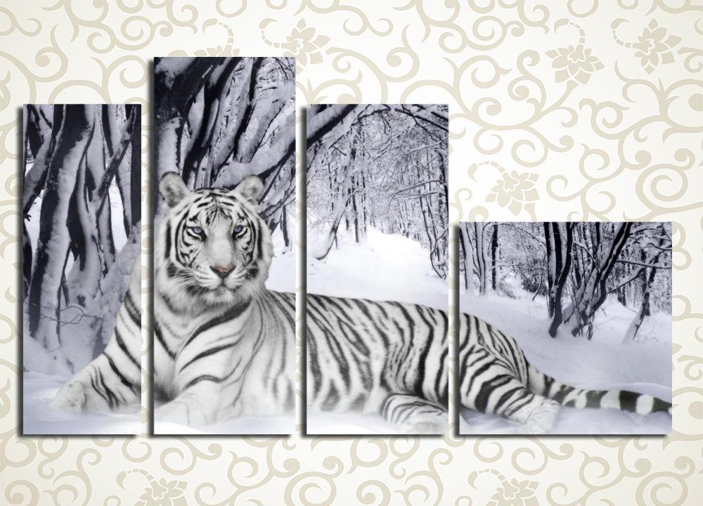 Модульная картина Хищный красавецМодульная картина «Хищный красавец» изображает в сдержанной цветовой гамме роскошного тигра, раскинувшегося на отдыхе среди заснеженной дальневосточной тайги. Это полотно станет царским украшением интерьера прихожей, холла, гостиной, зала, а также рабочего кабинета. Изображение состоит из 4 модулей различной формы. Строгий контроль качества и ручная сборка исключают дефекты.<br>