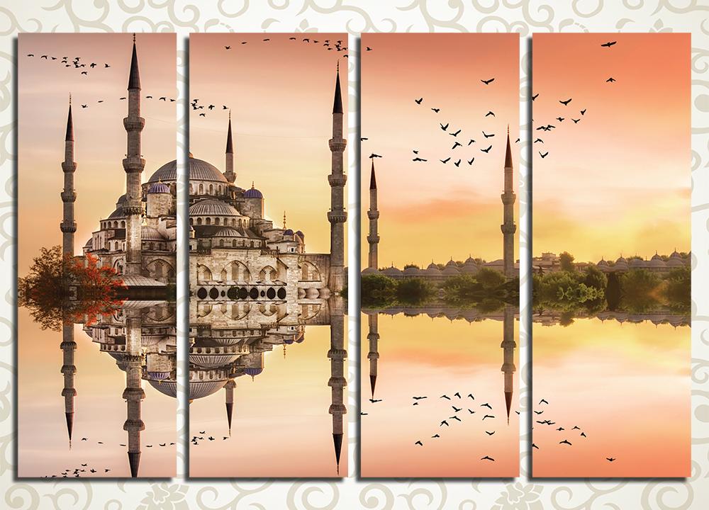 Модульная картина Закат над СтамбуломДобавить восточного колорита в оформление интерьера вы сможете с необычной модульной картиной «Закат над Стамбулом», которая изображает легендарную Голубую Мечеть. Оригинальный ракурс пейзажа впечатляет – мечеть отражается в абсолютно спокойной водной глади, а над ее минаретами на фоне желтого заката пролетают стаи птиц. Картина разделена на 4 блока, которые расположены вертикально и полностью симметрично, что придает изображению статичность.<br>