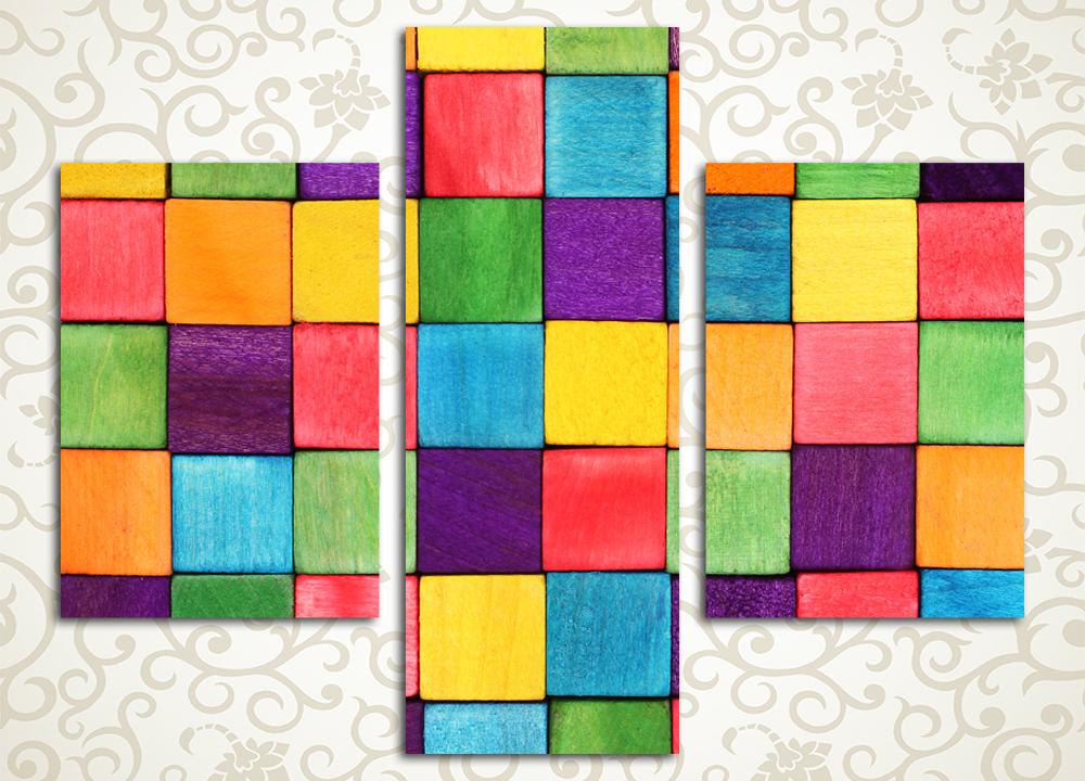 Модульная картина КубикиМодульная картина «Кубики» – абстрактное разноцветное изображение квадратного орнамента. Оно производит яркое и позитивное впечатление, и поэтому подойдет практически для любой комнаты дома – спальни, детской, холла, гостиной, зала и кухни. Картина состоит из 3 модулей вертикальной формы, каждый сегмент обладает прочным сосновым каркасом и обтянут вручную холстом. Холст обеспечивает максимально естественное и эстетичное восприятие изображения, а высокотехнологичные латексные краски сохранят первозданную сочность на много лет.<br>