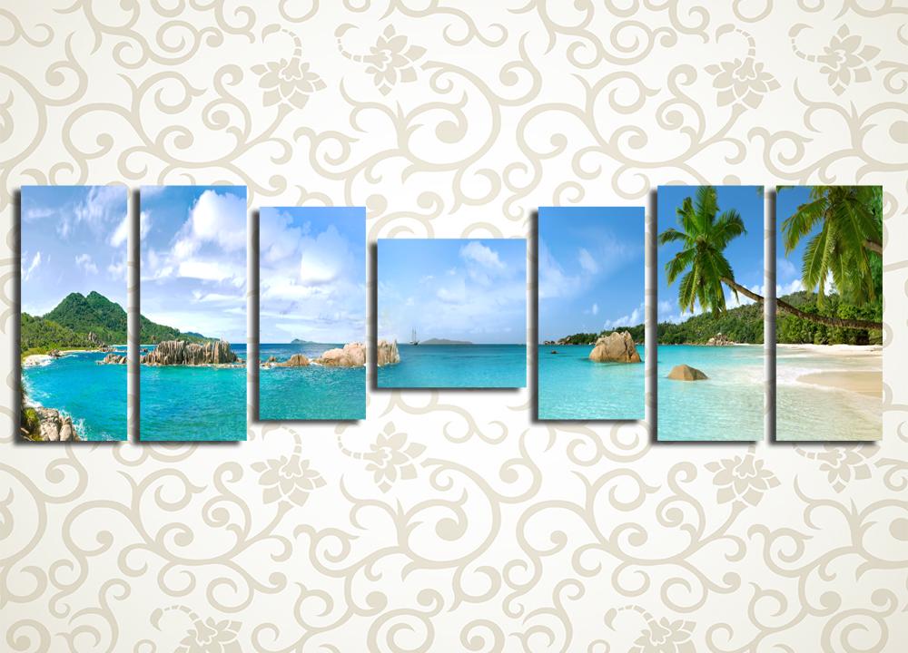 Модульная картина Панорама берега моряМодульная картина «Панорама берега моря» изображает лазурные воды тропического курорта. На переднем плане в кадре – пальмовые листья, а вдали возвышаются невысокие зеленые горы. Этот солнечный пейзаж станет ценным украшением прихожей, холла, гостиной, зала, а также спальни или кухни. Картина состоит из 7 модулей различной формы и имеет общую горизонтальную компоновку. Каждый сегмент изготовлен на прочной сосновой раме и вручную обтянут холстом под строгим контролем качества сборки. Благодаря этому практически исключено обнаружение брака либо каких-либо дефектов.<br>
